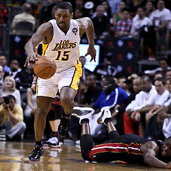March 10, 2011; Miami, FL, USA; Los Angeles Lakers small forward Ron Artest (15) drives down court after stealing the ball from Miami Heat shooting guard Dwyane Wade (3) during the second quarter at the American Airlines Arena.  Mandatory Credit: Derick E. Hingle