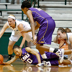 November 19, 2011; New Orleans, LA; LSU Lady Tigers guard Adrienne Webb (10) and Tulane Green Wave forward Danielle Blagg (20) scramble for possession during the first half of a game at Avron B. Fogelman Arena.  Mandatory Credit: Derick E. Hingle-US PRESSWIRE