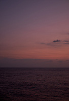 Pastel colored sky and clouds over the Pacific Ocean at dawn.  Image 1 of 21  for a panorama taken with a Fuji X-T1 camera and 35 mm f/1.4 lens  (ISO 400, 35 mm, f/2.8, 1/30 sec). Raw images processed with Capture One Pro and stitched together with AutoPano Giga Pro.