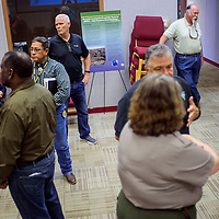 Community members and area residents meet with representatives from the Parks Service and the Corps of Engineers during a community meeting about ordinance disposal at the El Malpais visitors center in Grants Wednesday.
