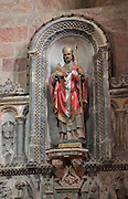 Polychrome statue of Saint Volusian, 7th bishop of Tours, who died c. 495 AD, in Saint Volusian Abbey, or the Abbatiale Saint-Volusien, in Foix, Ariege, Midi-Pyrenees, France. The original abbey church was built in the 12th century, but was later destroyed and rebuilt in the 17th century. The abbey houses the relics of St Volusian, and its buildings now house the Prefecture of the Ariege. Picture by Manuel Cohen