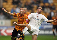 Photo: Rich Eaton.<br /> <br /> Wolverhampton Wanderers v Luton Town. Coca Cola Championship. 26/08/2006. Left Rob Edwards of Wolves and Rohan Vine clash