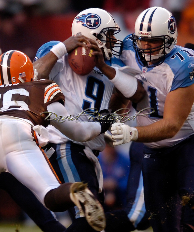 MORNING JOURNAL/DAVID RICHARD.Cleveland's Kenard Lang gets a piece of quarterback Steve McNair on the game's final play - an interception by the  Browns.