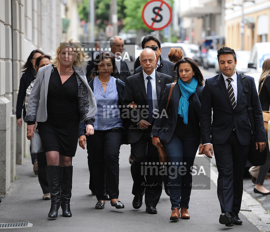 CAPE TOWN, SOUTH AFRICA - Thursday 8 October 2014, Prakash Dewani (middle, father of Shrien Dewani, walks with family members towards the entrance of the court building during Day 3 of the Shrien Dewani trial at the Cape High Court before Judge Jeanette Traverso. Dewani is caused of hiring hit men to murder his wife, Anni. Anni Ninna Dewani (n&eacute;e Hindocha; 12 March 1982 &ndash; 13 November 2010) was a Swedish woman who, while on her honeymoon in South Africa, was kidnapped and then murdered in Gugulethu township near Cape Town on 13 November 2010 (wikipedia).<br /> Photo by Roger Sedres