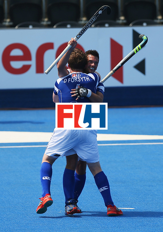 LONDON, ENGLAND - JUNE 20:  Willie Marshall of Scotland celebrates with David Forsyth (4) as he scores their first goal during the Pool B match between Scotland and Canada on day six of the Hero Hockey World League Semi-Final at Lee Valley Hockey and Tennis Centre on June 20, 2017 in London, England.  (Photo by Alex Morton/Getty Images)