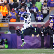 Seattle receiver Doug Baldwin came across the middle, leapt high and snagged this pass from Russell Wilson with one hand and completed the catch in the third quarter.