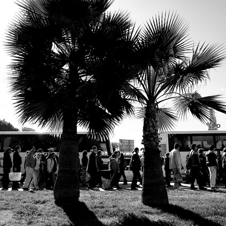 A line of people waiting to cross into the United States forms in Tijuana, Baja California, Mexico, on Monday, Feb. 4, 2008.