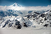 Known as Shaa Tléin by the local Tlingit indian tribe in Yakutat AK, this is more commonly known as Mount Saint Elias. It rises 18,008 feet only 10 miles from coastal waters. The immense vertical relief is rarely climbed due to poor routes and usually poor weather, but a few expeditions have done it successfully.