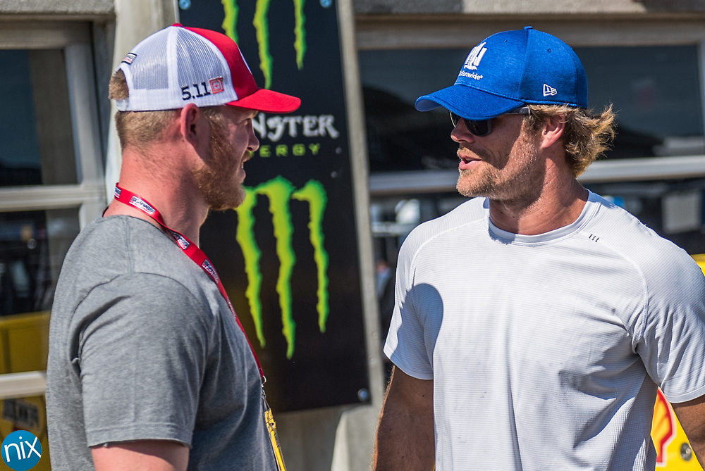 Carolina Panthers tight end Greg Olsen talks with Minnesota Vikings tight-end Kyle Rudolph in the garages of Charlotte Motor Speedway during the Monster Energy NASCAR All-Star Race Saturday.