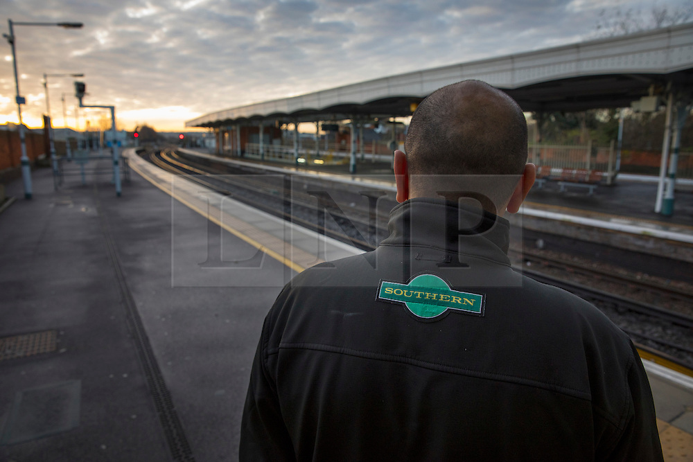 © Licensed to London News Pictures. 14/12/2016. London, UK. A Southern Rail employee looks out at closed Selhurst station at first light. Hundreds of thousands of rail passengers face a second day of a 3 day rail strike in an escalating dispute over the role of conductors and drivers. Photo credit: Peter Macdiarmid/LNP