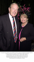 TV presenter JUDITH CHALMERS and her husband MR NEIL DURDEN-SMITH,  at a luncheon in London on 6th March 2001.OLW 33