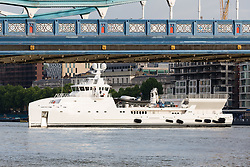 © Licensed to London News Pictures. 18/05/2017. LONDON, UK.  The Game Changer, a newly built superyacht support vessel turns around in the lower pool as she prepares to leave London under Tower Bridge on the River Thames after her first visit to the capital. The 70-meter superyacht support vessel has a large helideck so that yacht owners can take larger helicopters on long range flights to their mother yachts and 250 square metres of open deck space for tenders and toys, plus offices, facilities and accommodation for 22 crew and staff below deck. Built by Dutch Shipbuilder, Damen, the Game Changer was launched in March this year and recently completed sea trials in the North Sea. Photo credit: Vickie Flores/LNP