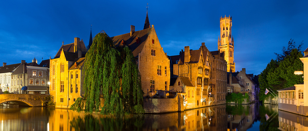 Famous picturesque scene of canal buildings and belfry at the Rozenhoedkaai in Bruges, Belgium