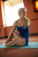 Woman practicing yoga. Kim Tang, Bikram yoga teacher in Johsua Tree, CA