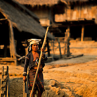 Akha Hill Tribe Woman cuts bamboo, Muang Singh, Laos