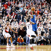 07 December 2013: Dallas Mavericks shooting guard Monta Ellis (11) makes the game winning shot at the buzzer with 1.9 second remaining over Portland Trail Blazers shooting guard Wesley Matthews (2) during the Dallas Mavericks 108-106 victory over the Portland Trail Blazers at the Moda Center, Portland, Oregon, USA.