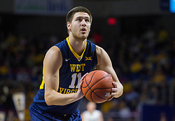 Dec 17, 2015; Charleston, WV, USA; West Virginia Mountaineers forward Nathan Adrian (11) shoots a foul shot during the first half against the Marshall Thundering Herd at the Charleston Civic Center . Mandatory Credit: Ben Queen-USA TODAY Sports