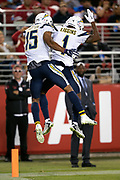 Los Angeles Chargers wide receiver Andre Patton (15) leaps and celebrates with Los Angeles Chargers wide receiver Justice Liggins (1) after Patton catches a 5 yard touchdown pass good for a 20-7 third quarter Chargers lead during the 2018 NFL preseason week 4 football game against the San Francisco 49ers on Thursday, Aug. 30, 2018 in Santa Clara, Calif. The Chargers won the game 23-21. (©Paul Anthony Spinelli)