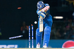 © Licensed to London News Pictures. 07/10/2012. Sri Lankan batsmen Tillakaratne Dilshan gets bowled during the World T20 Cricket Mens Final match between Sri Lanka Vs West Indies at the R Premadasa International Cricket Stadium, Colombo. Photo credit : Asanka Brendon Ratnayake/LNP