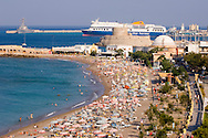 An aerial view of Elli Beach and a ferry in the harbour at Rhodes Town, Rhodes,<br /> Dodecanese Islands, Greece
