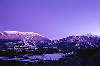 Whistler and Blackcomb Mountains rise above the village of Whistler, BC