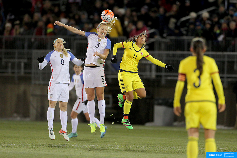 Sam Mewis, USA, heads clear while challenged by Catalina Usme, (right), Colombia, during the USA Vs Colombia, Women's International friendly football match at the Pratt & Whitney Stadium, East Hartford, Connecticut, USA. 6th April 2016. Photo Tim Clayton