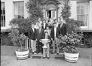 Sam Maguire Cup At Abbeyville..1986..22.09.1986..09.22.1986..22nd September 1986..Members of The Kerry,All Ireland winning team payed a courtesy call to Abbeyville, the home of Mr Charles Haughey T.D. They carried with them The Sam Maguire Cup, won at Croke Park the previous day..Pictured on the steps of Abbeyville are members of the Kerry All ireland winning team,manager Mick O'Dwyer,Charles Haughey TD and members of the Haughey family.