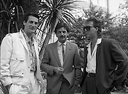 "Sade and Tony Hadley Interviews.  P92..1984.21.08.1984..08.21.1984..21st August 1984..As part of his interview sessions for ""Video File"" for R.T.E., Marty Whelan interviewed international music stars. The interviews were held in the R.T.E.,studios and at various hotels throughout the city...Image shows R.T.E.,personality Marty Whelan (centre) with Spandau Ballet members Tony Hadley and Martin Kemp."