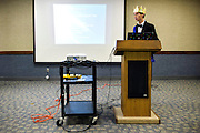 Anaheim , California - April 11, 2015: Grand Duke Jacob Felts, 16, from Broslavia, gives a presentation titled &quot;Challenges to Intermicronational Trade.&quot; His solution? Form the National American InterMicronational Trade Organization, or &quot;NAIMTO.&quot; Micronations are expensive to run points out Grand Duke Jacob, and proposes that micronations in aligned with NAIMTO sell &quot;boring stuff&quot; -- reusable items that people will need to repurchase. The Republic of Molossia sells Supremo Soap, and Broslovia is attempting to make recycled paper.  <br /> <br /> <br /> Broslovia is a micronation located in Albuquerque, New Mexico. It's claimed province not only over Grand Duke Jacob's house, Feltasia, the capital of Broslovia, and his friend Lord Henry's house, titled New Southland, but also Pluto, the dwarf planet. <br /> <br /> When asked if Broslavia holds elections he said his nation is an Absolute Monarchy, &quot;I'm a libertarian, so I do enough to be a bad leader.&quot;<br /> <br /> MicroCon 2015 is a Micronation conference held at the Anaheim Central Library.<br /> CREDIT: Matt Roth