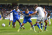 Gillingham forward Cody MacDonald (10) and Oldham Athletic defender Cameron Burgess (5) during the EFL Sky Bet League 1 match between Gillingham and Oldham Athletic at the MEMS Priestfield Stadium, Gillingham, England on 8 October 2016. Photo by Martin Cole.