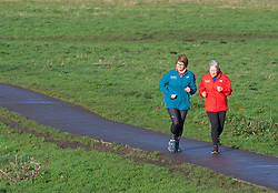 ©Licensed to London News Pictures 09/01/2020<br /> Sidcup ,UK  Two runners seem to be enjoying the brisk weather. Cold windy weather at Footscray Meadows in Sidcup, South East London. Photo credit: Grant Falvey/LNP