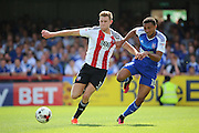 Brentford defender Callum Elder (3) and Ipswich midfielder Grant Ward (18) battling for the ball during the EFL Sky Bet Championship match between Brentford and Ipswich Town at Griffin Park, London, England on 13 August 2016. Photo by Matthew Redman.