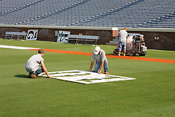 The University of Virginia Sports Field Management staff prepares David A. Harrison III Field at Scott Stadium at the Carl Smith Center for the 2007 Football season on September 6, 2007 in Charlottesville, VA.  The first home game for the Virginia Cavaliers is scheduled against the Duke University Blue Devils on September 8, 2007