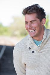 man laughing outdoors