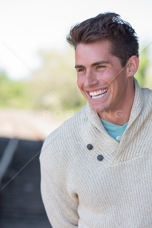 man laughing outdoors