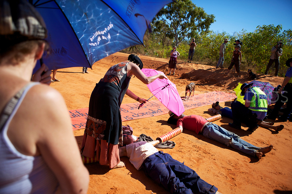 Dozens of protesters formed human chains by locking themselves onto barrels on Manari Rd. in today's bid to halt work on Woodside's gas factory project near James Price Point. Broome. WA