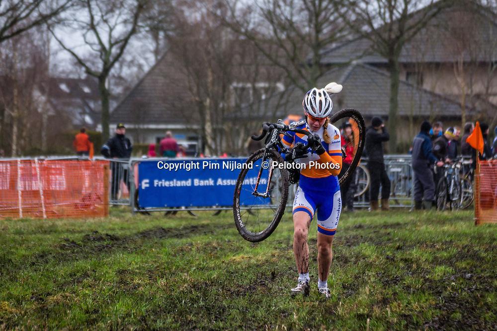 Anna VAN DER BREGGEN (NED) running in the mud at International Cyclo-cross Surhuisterveen: Centrumcross (UCI/C2) - Surhuisterveen, The Netherlands - 2nd January 2014 - Photo by Pim Nijland / Peloton Photos