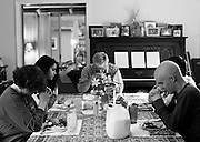 Kevin, right, prays with his family before dinner at their home. - 4/14/2009