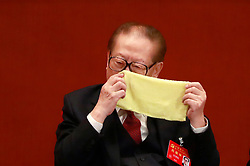epa06272492 Former Chinese President Jiang Zemin wipes his nose with a handkerchief during the opening ceremony of the 19th National Congress of the Communist Party of China (CPC) at the Great Hall of the People (GHOP) in Beijing, China, 18 October 2017. China holds the 19th Congress of the Communist Party of China, the country's most important political event where the party's leadership is chosen and plans are made for the next five years. Xi Jinping is expected to remain as the General Secretary of the Communist Party of China for another five-year term.  EPA-EFE/HOW HWEE YOUNG