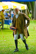8/18/12 11:33:43 AM - Warwick, PA. -- A reenactor walks through camp during a revolutionary war reenactment at the Moland House August 18, 2012 in Warwick, Pennsylvania. -- (Photo by William Thomas Cain/Cain Images)..