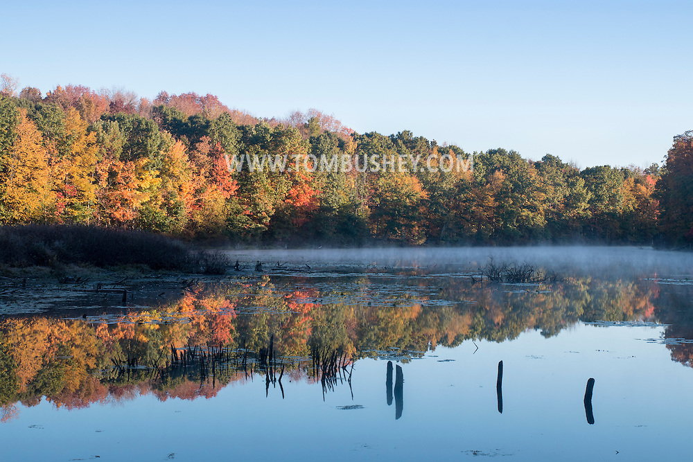 Mount Hope, New York - Colorful leaves are reflected in the water of a lake on Oct. 15, 2016.