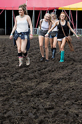 © Licensed to London News Pictures . 08/06/2014 . Heaton Park , Manchester , UK . Festival goers trudge through thick mud in the sunshine at The Parklife music festival in Heaton Park Manchester as the warm weather returns . Photo credit : Joel Goodman/LNP