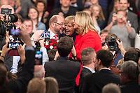 19 MAR 2017, BERLIN/GERMANY:<br /> Martin Schulz (L), SPD, mit Blumen nach seiner Wahl zum SPD Parteivorsitzenden und SPD Spitzenkandidat der Bundestagswahl, mit Hannelore Kraft (M), SPD, Ministerpraesidentein Nordrhein-Westfalen, und Anke Rehlinger (R), Spintzenkandidtain SPD Saarland, a.o. Bundesparteitag, Arena Berlin<br /> IMAGE: 20170319-01-078<br /> KEYWORDS: party congress, social democratic party, candidate, Jubel, Smartphone
