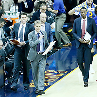 08 June 2016: Golden State Warriors head coach Steve Kerr is seen next to Luke Walton, and Jarron Collins during the Cleveland Cavaliers 120-90 victory over the Golden State Warriors, during Game Three of the 2016 NBA Finals at the Quicken Loans Arena, Cleveland, Ohio, USA.