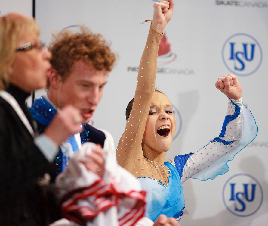 20101030 -- Kingston, Ontario -- Lubov Iliushechkina and Nodari Maisuradze of Russia celebrate their win in the pairs competition at Skate Canada International in Kingston, Ontario, Canada, October 30, 2010. <br /> AFP PHOTO/Geoff Robins