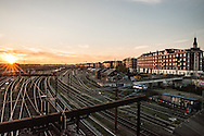 The sunsets over the train tracks at Dybbølsbro Station along Ingerslevsgade in Copenhagen.