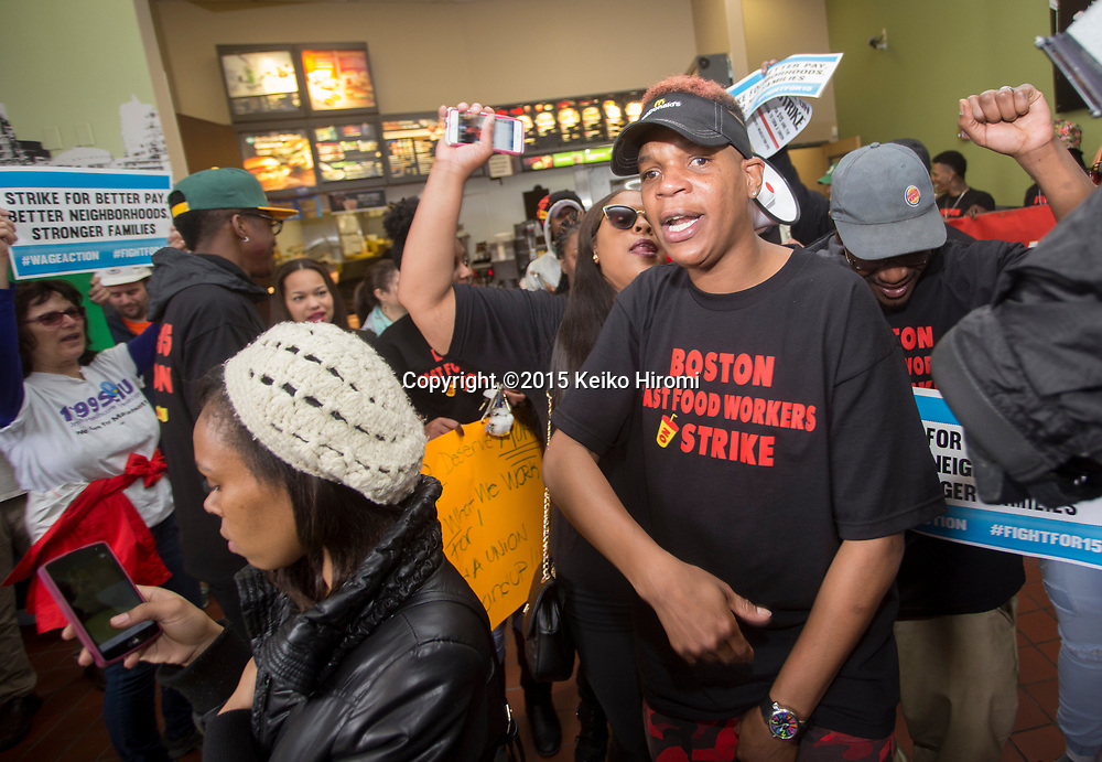 """Boston area low wage workers are joined by, BU students and adjuncts, airport workers, health care workers, and other fast food workers in a series of actions that call to """"Fight For $15"""" outside of McDonald in Codman Sq, Dorchester, MA on April 14, 2015."""
