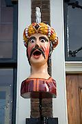 A gaper head identifying pharmacist shop, Delft, Netherlands