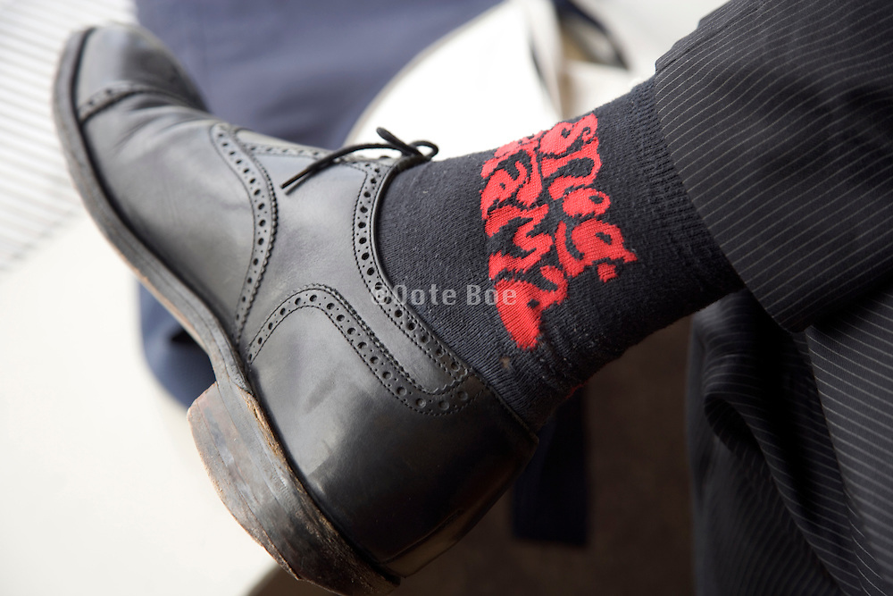 businessman wearing socks with funny text