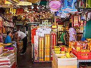 "26 AUGUST 2013 - BANGKOK, THAILAND: People shop for supplies the Hungry Ghost Month in Bangkok. The seventh lunar month (August - September in 2013) is when the Chinese community believes that hell's gate will open to allow spirits to roam freely in the human world for a month. Many households and temples will hold prayer ceremonies throughout the month-long Hungry Ghost Festival (Phor Thor) to appease the spirits. During the festival, believers will also worship the Tai Su Yeah (King of Hades) in the form of paper effigies which will be ""sent back"" to hell after the effigies are burnt.      PHOTO BY JACK KURTZ"
